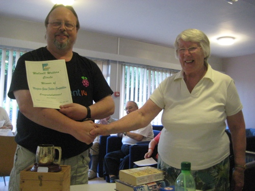 Stuart Williams receives the Marjorie Green Trophy from Margaret Wood