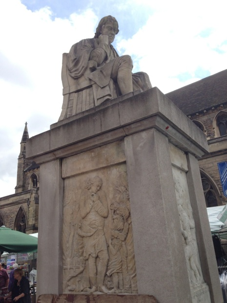 Dr Samuel Johnson looks down on Lichfield Market, wishing he had a copy of Astounding to read