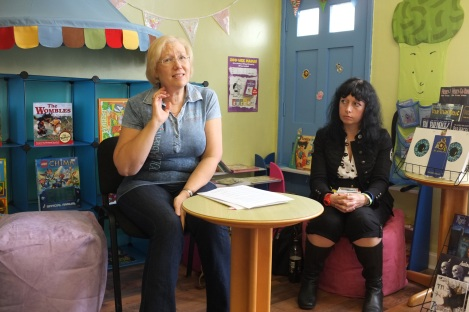 Steampunk author and singist LM Cooke (right) listens to Alison Reed of Walsall Writers' Circle